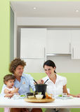 Meat fondue. Family eating meat fondue at home. Copy space royalty free stock image