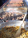 Meat food cooked outdoor, at traditional food fair Royalty Free Stock Photos