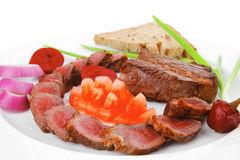 Meat food : roast red meat slices served on white plate Stock Images