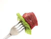 Meat on fork Stock Photos