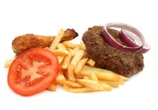 Meat and french fries Royalty Free Stock Images