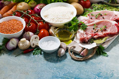 Meat and fresh foods for cooking soup on a blue background Stock Photos