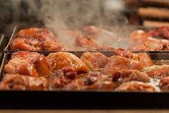 Meat is fried on a big frying pan royalty free stock image