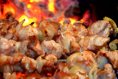 Meat is fried on fire royalty free stock images