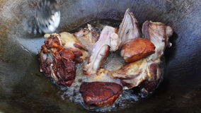Meat frying in campfire. Closeup. stock video footage