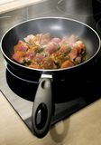 Meat on frying pan Stock Photography