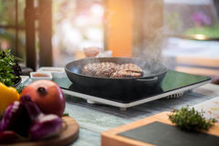 Meat on a frying pan. Royalty Free Stock Photography