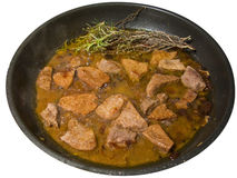 Meat in a frying pan, isolated stock images