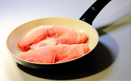 The meat in frying pans. Prepare meals, grilled meat Stock Image