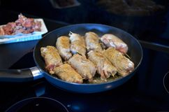 Meat frying Stock Images