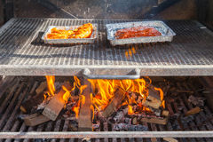 Meat getting ready on bbq Stock Images