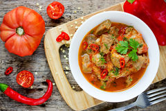 Meat goulash , pork stew with red bell pepper and tomatoes sauce Royalty Free Stock Images