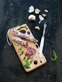 Meat gourmet snack. Salami, garlic, baguette and Stock Photography