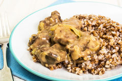 Meat with gravy, buckwheat Royalty Free Stock Photo