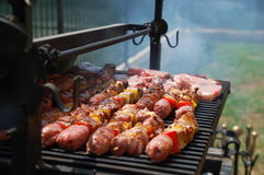 Meat on the grill. During a mid august party Royalty Free Stock Photo