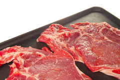 Meat on grill. On a white background Stock Images