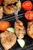 Meat on the grill. Pork with vegetables on the grill Stock Images