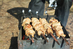 The meat on the grill. Delicious barbecue from pork meat Royalty Free Stock Images