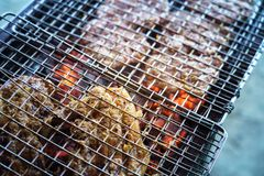 Meat on the grill with flame. Outdoor bbq stock photo