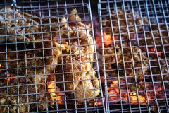 Meat on the grill with flame. Outdoor bbq.  stock photo