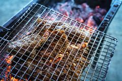 Meat on the grill with flame. Outdoor bbq royalty free stock photography