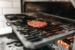 Meat on grill oven, burger cooking Stock Photo