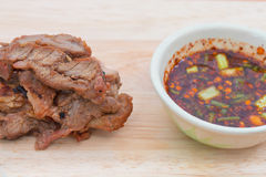 Meat grill with sauce on cutting board Royalty Free Stock Photography