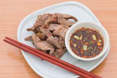 Meat grill with sauce on dish Royalty Free Stock Images