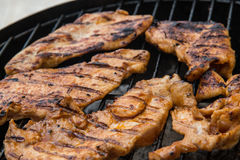 Meat on Grill. Meat slice on the grill Royalty Free Stock Photography