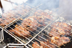 Meat on a grill with smoke Royalty Free Stock Image