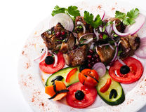 Meat grill. With tomatoes and cucumbers  on white Stock Photography