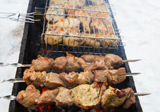 Meat grilled over charcoal on the grill Royalty Free Stock Photo