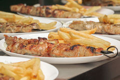 Meat grilled on skewers with fries Greek cuisine. souvlaki Stock Photography