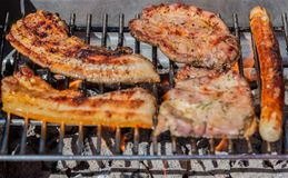 Meat grilling on a charcoal grill. In Germany S. H royalty free stock photography
