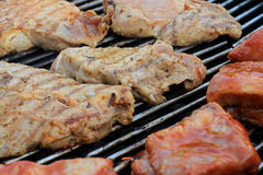 Meat grilling. Preparing spare ribs and shoulder on bbq grill Royalty Free Stock Photo