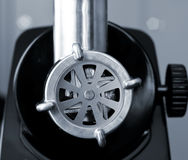 Meat grinder. Close up of electric meat grinder with cutting blades, Shallow DOF stock photo