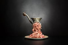 Meat grinder on a black background Royalty Free Stock Images
