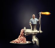 Meat grinder on a black background Stock Images