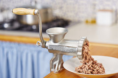 Meat grinder in domestic kitchen Stock Photo