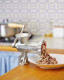 Meat grinder in domestic kitchen Royalty Free Stock Photo