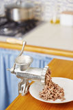 Meat grinder in domestic kitchen Stock Photos