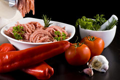 Meat grinder with mince and vegetables Royalty Free Stock Images