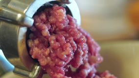 Meat from meat grinder. Meat grinder for minced meat close-up production of meat products at home stock video footage