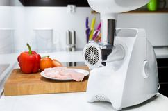 Meat grinder in modern kitchen. Royalty Free Stock Photography