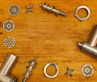 Meat grinder part lying on table Stock Photos