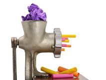Meat grinder recycling garbage and colorful paper stock images