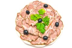 Meat with herbs on a plate Royalty Free Stock Photography