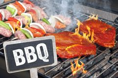 Meat on a hot grill with flames royalty free stock images