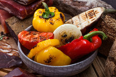 Meat jerky and grilled vegetables stock photos