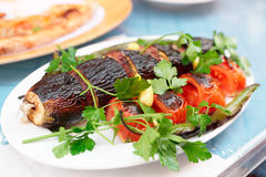 Meat kebab with eggplant on plate Stock Photo